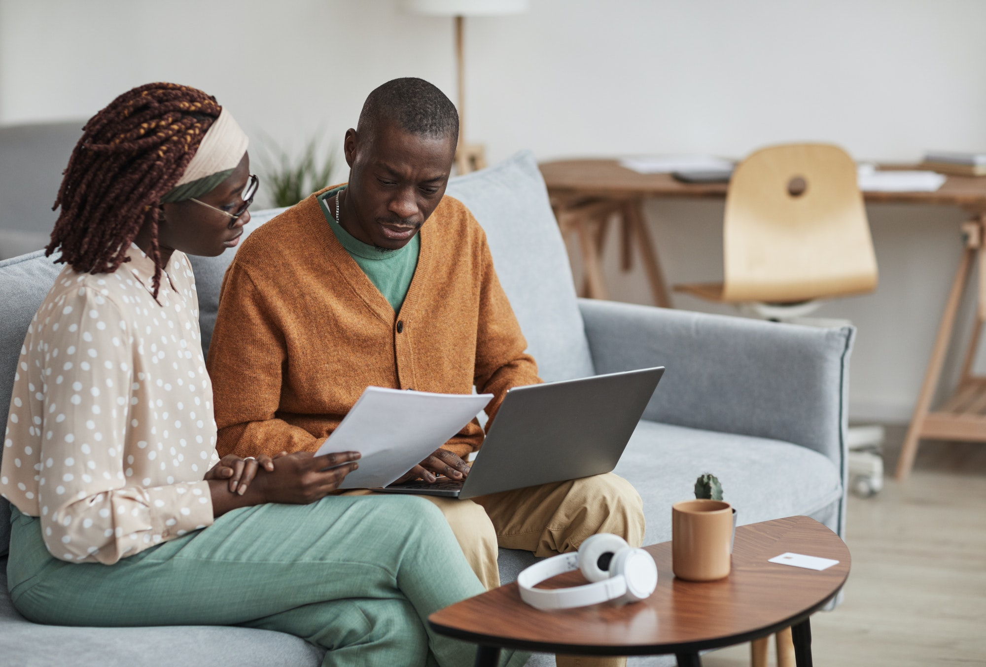 Modern African American Couple Working